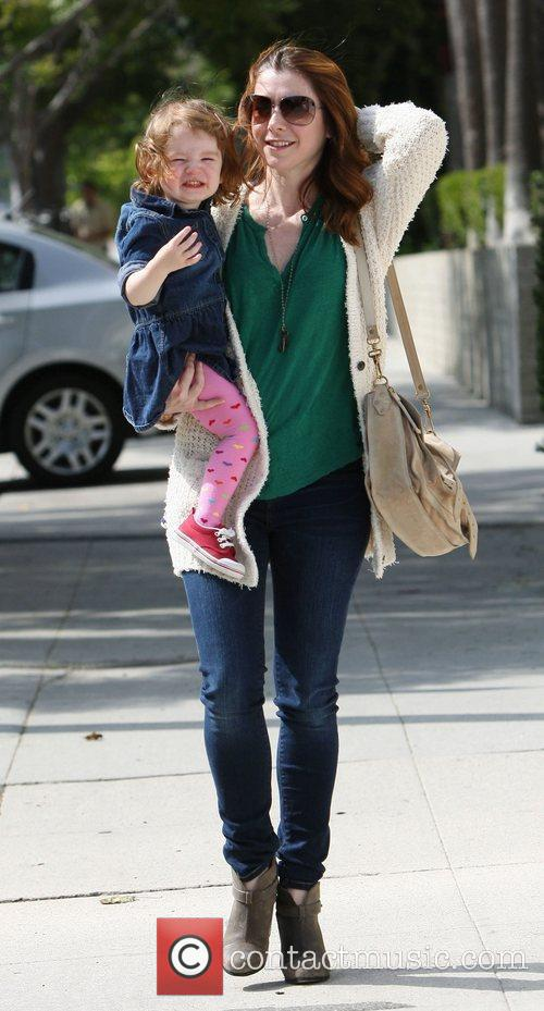 Alyson Hannigan and daughter Satyana out walking in...