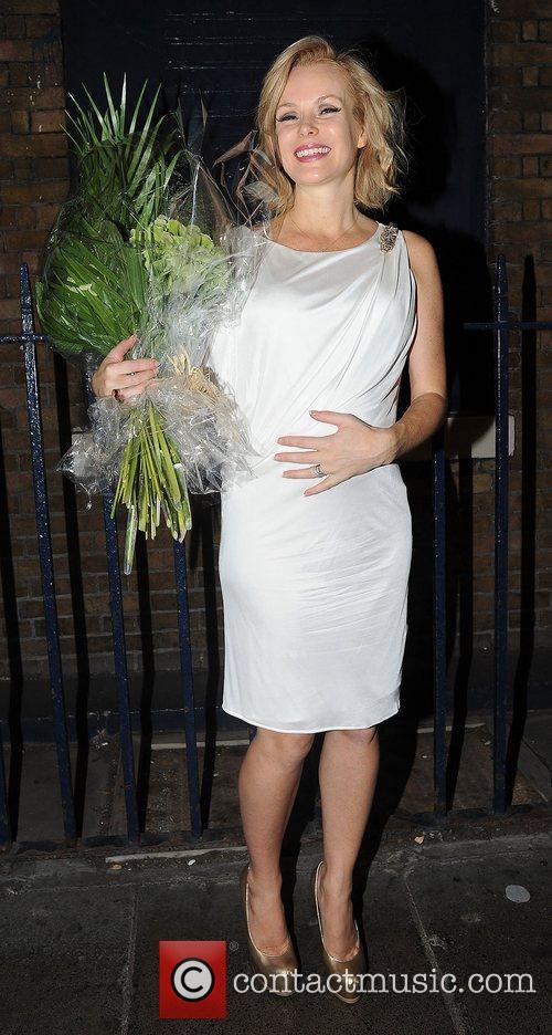 Pregnant Amanda Holden leaves the Theatre Royal celebrating...