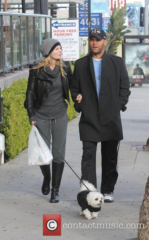 Amaury Nolasco and his girlfriend walking their dog...