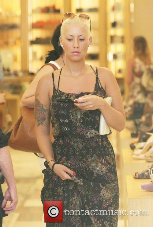 Amber Rose was spotted shopping for shoes at...