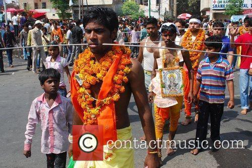 Hindu devotees of Devi Maha Mariamman get their...