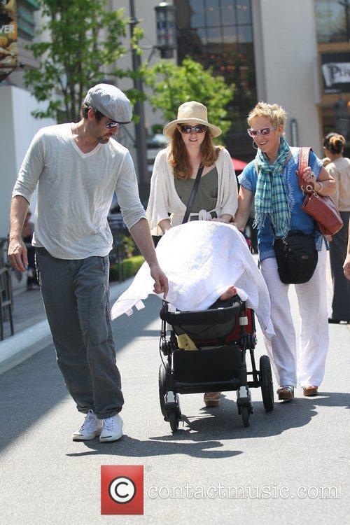 Amy Adams, her fiancee Darren Legallo and their...