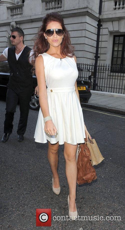 Amy Childs leaving her hotel