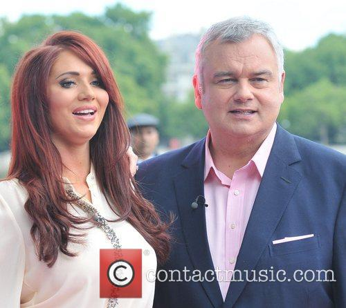 Amy Childs and Eamon Holmes presenting a segment...