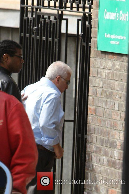 Mitch Winehouse outside the coroner's office following his...