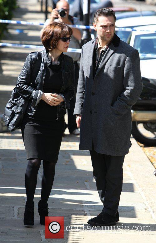 Reg Traviss outside Amy Winehouse's house following her...