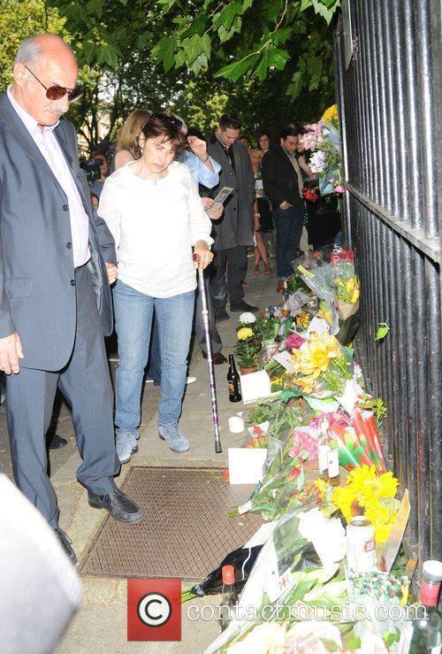 Janis Winehouse, Reg Traviss outside Amy Winehouse's house...