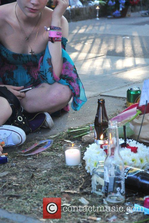 Fans gather outside Amy Winehouse's apartment to celebrate...