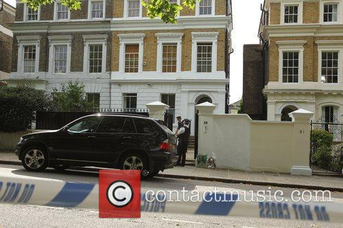 Police outside the house of Amy Winehouse following...
