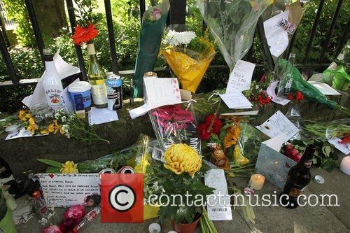 Tributes outside the house of Amy Winehouse following...