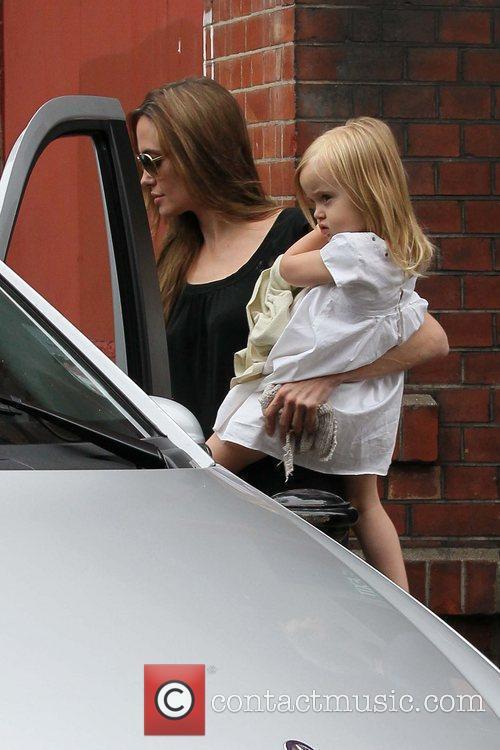 Angelina Jolie carrying daughter Vivienne Jolie-Pitt  leaving...