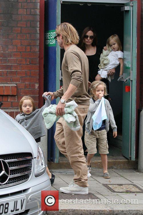 Brad Pitt and Angelina Jolie with children Vivienne,...