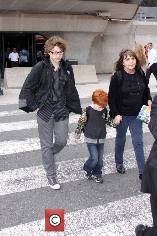 Arrives at Washington Dulles Airport with his family