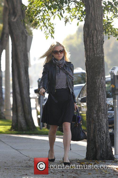 Anna Paquin returns to her car after visiting...