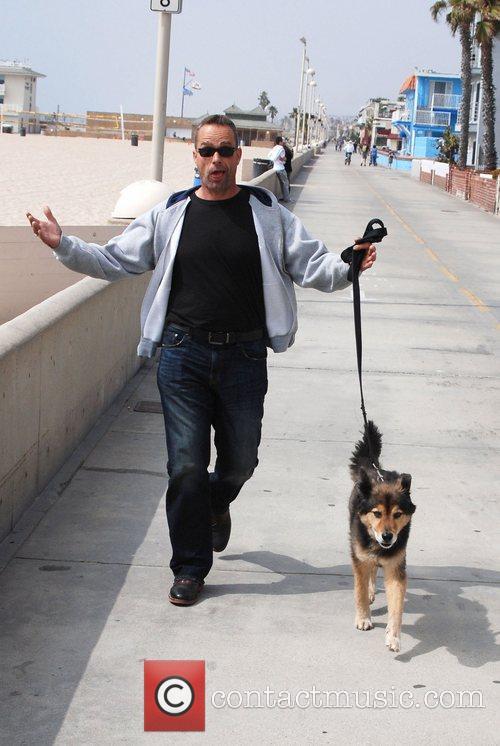 Anthony Vitale walking his dog along Hermosa Beach