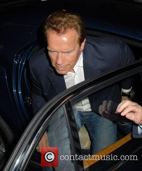 Arnold Schwarzenegger mobbed by fans as he arrives...
