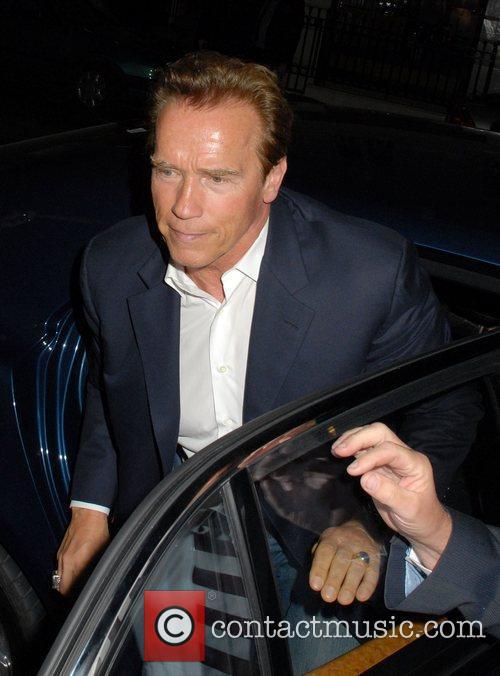 Arnold Schwarzenegger mobbed by fans as he arrives...