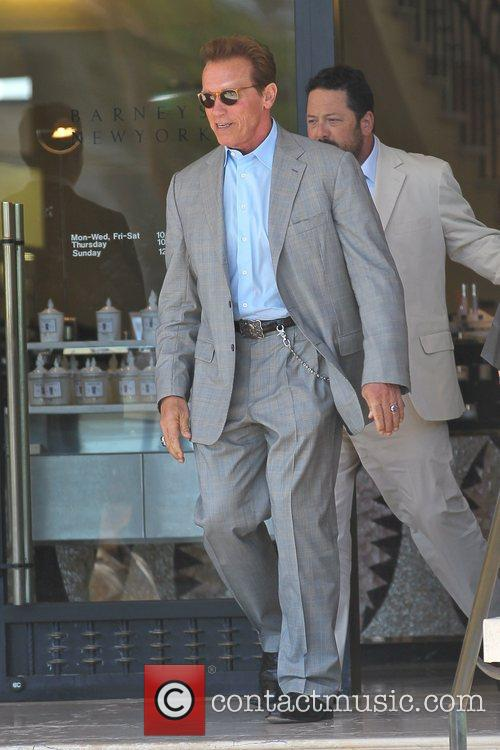 Arnold Schwarzenegger  leaving Barneys New York in...