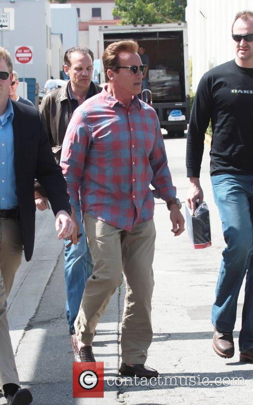 Arnold Schwarzenegger leaving Cafe Roma after having lunch