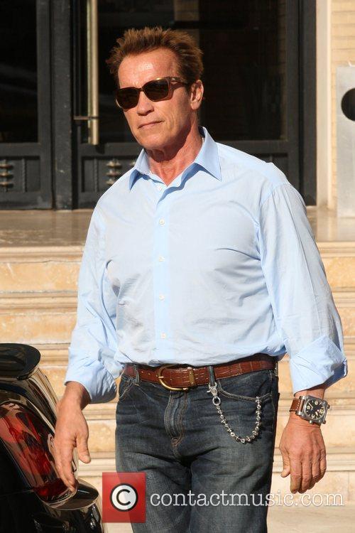 Arnold Schwarzenegger departs Barneys New York in Beverly...