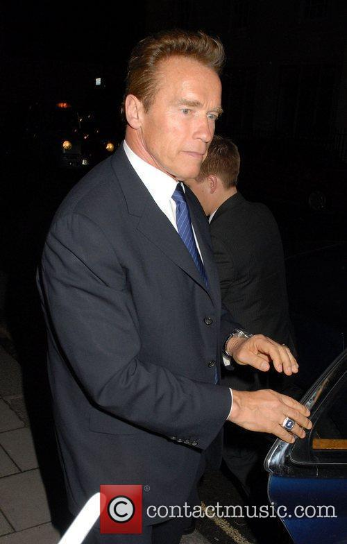 Arnold Schwarzenegger arrives at his hotel. London, England
