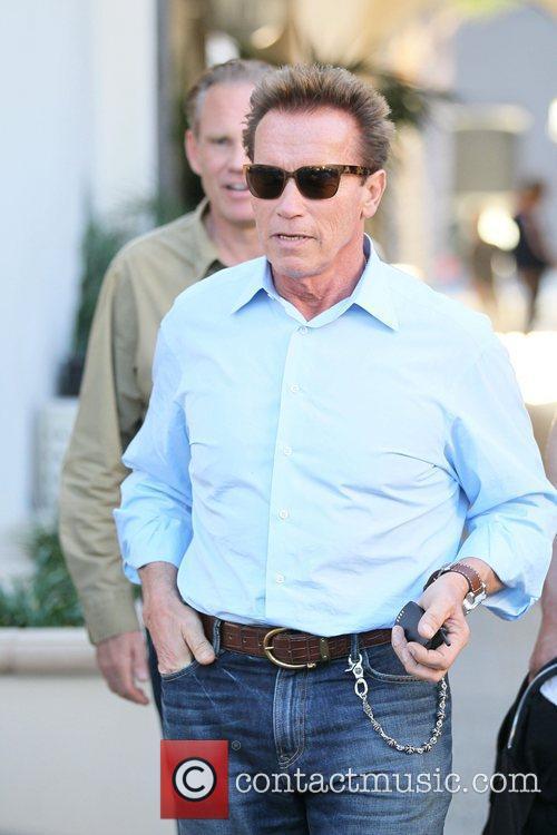 Arnold Schwarzenegger has his hair cut at Giuseppe...