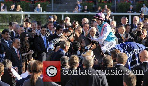 Frankel returns to the winners enclosure after winning...