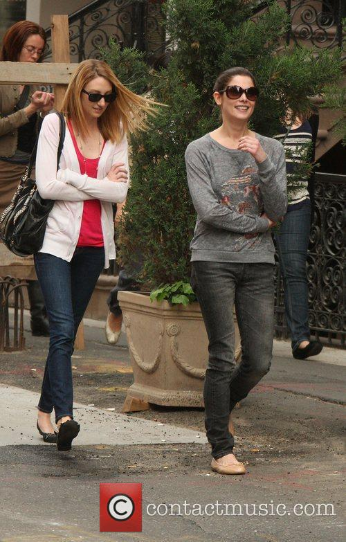 Ashley Greene out and about with a female...