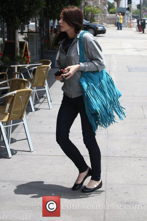 Ashley Greene is seen toting a turquoise fringe...