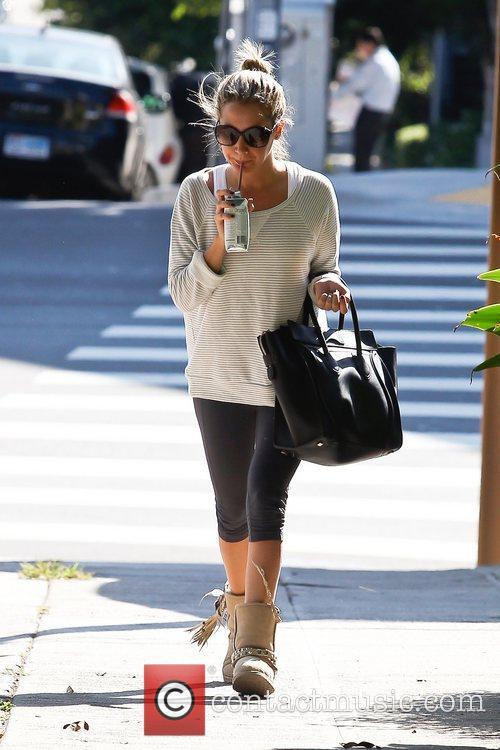 Ashley Tisdale gets an organic drink while out...