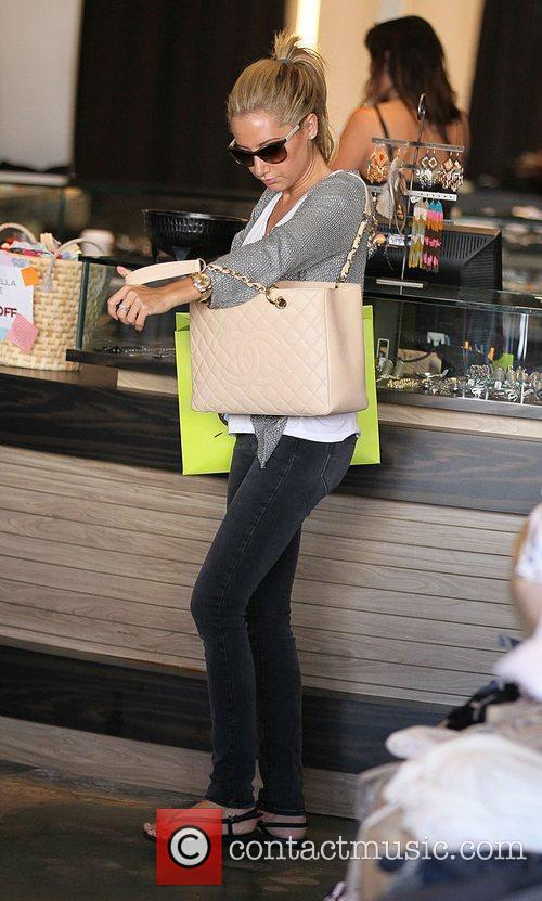 Ashley Tisdale continues her day of shopping with...
