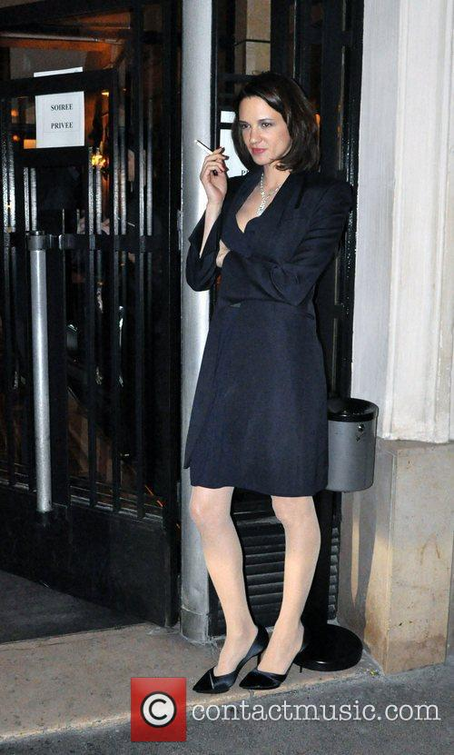 Actress Asia Argento smoking a cigarette outside Mathis...