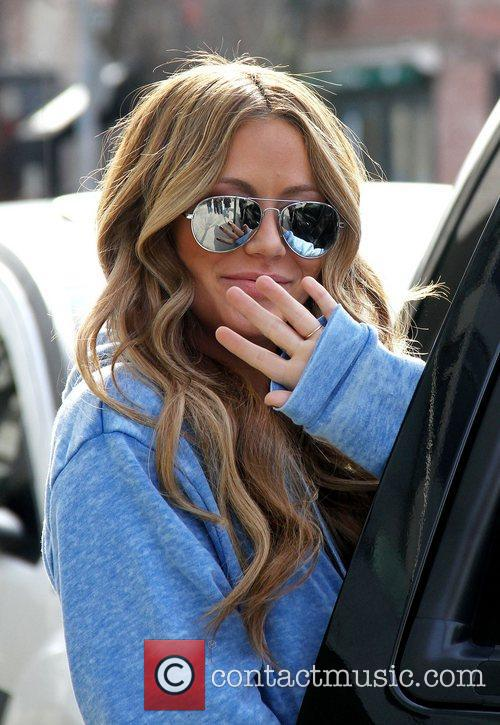 Aubrey O'Day out and about wearing mirror aviator...