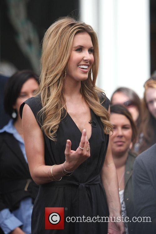 Audrina Patridge filming an interview for the entertainment...