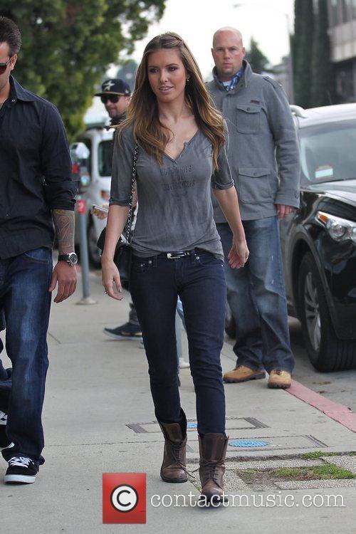 Wearing skinny jeans as she shops in West...