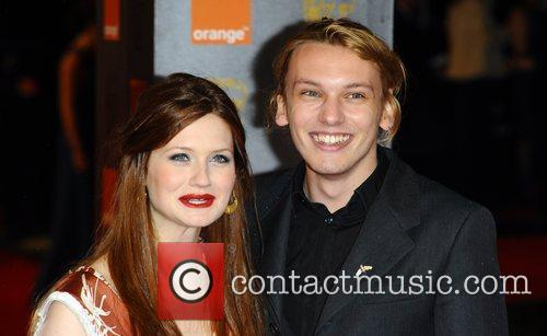 Bonnie Wright and Jamie Campbell Orange British Academy...