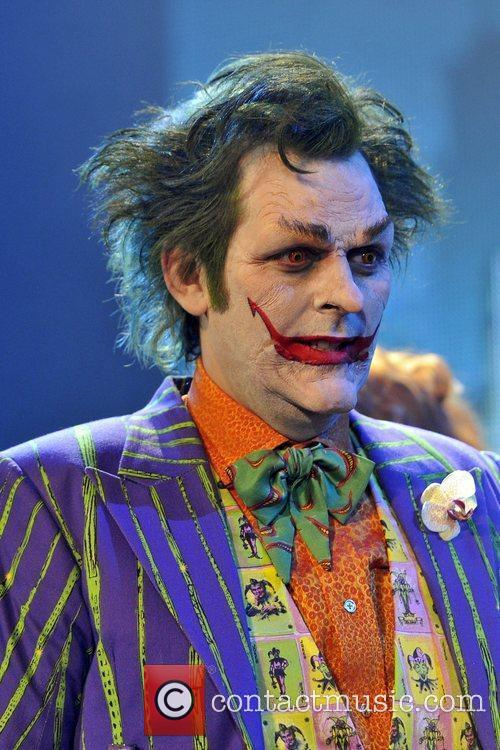 The Joker, played by Mark Frost, appears to...