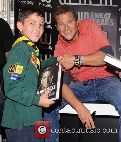 Bear Grylls  promoting and signing copies of...