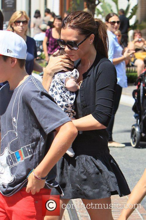 Victoria Beckham and Brooklyn 8