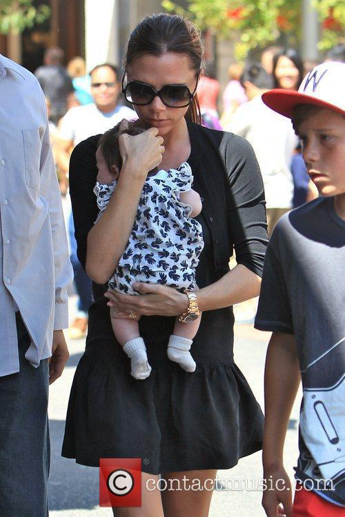 Victoria Beckham and Brooklyn 16