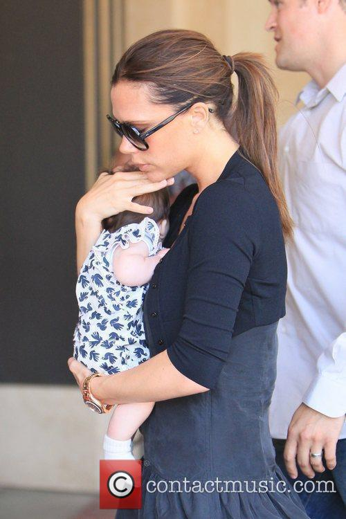 Victoria Beckham and Brooklyn 24
