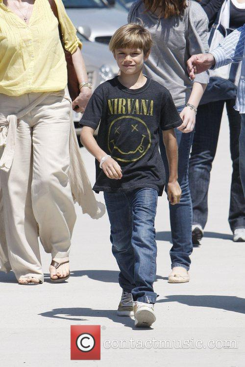 Romeo Beckham wearing a 'Nirvana' T-Shirt, heads to...
