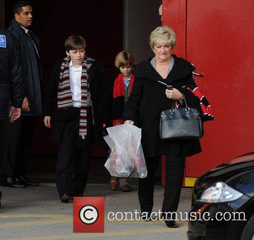 David Beckham leaves Old Trafford with his sons...