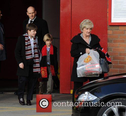 Brooklyn, Romeo and Sandra Beckham David Beckham leaves...