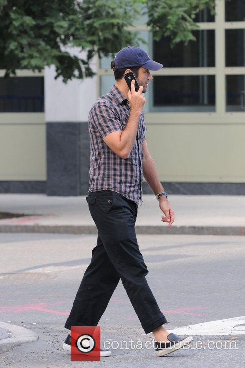 Benjamin Millepied talking on his mobile phone while...