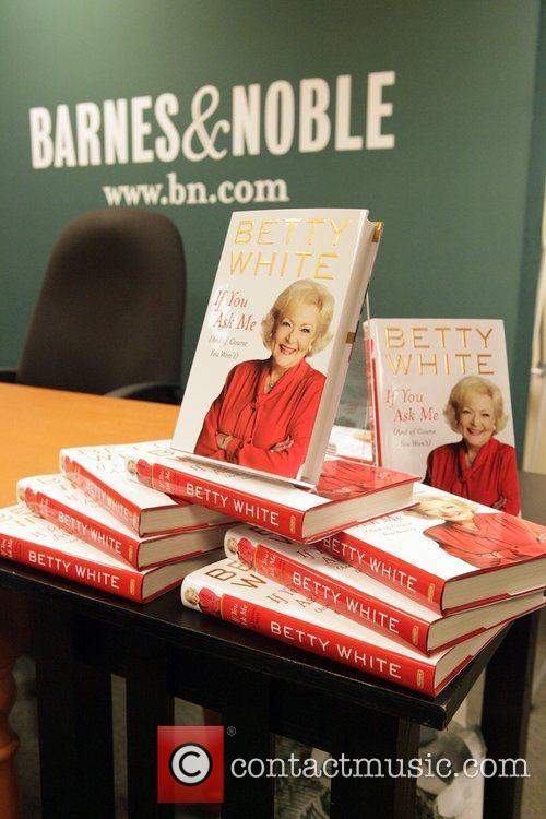 Betty White signs copies of her new book...