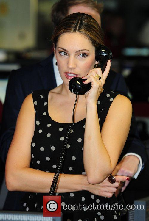 Kelly Brook,  on the trading floor of...