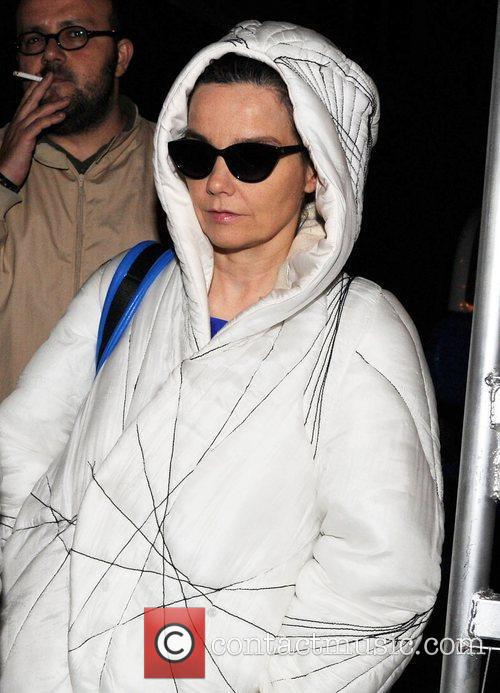 Bjork returns to her car after performing at...