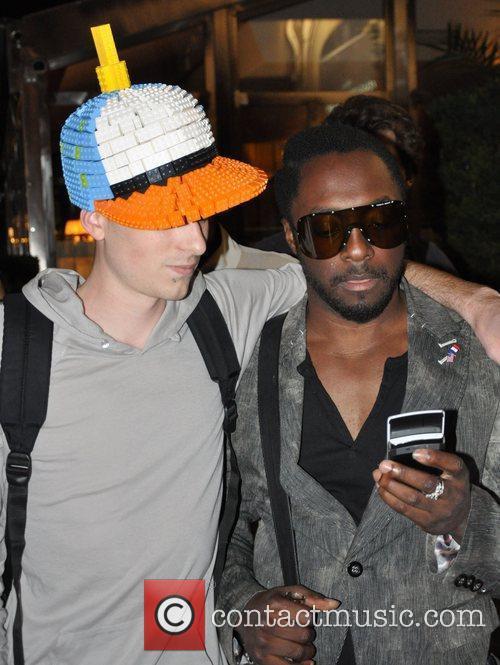 will.I.am greets a fan wearing a Lego hat...