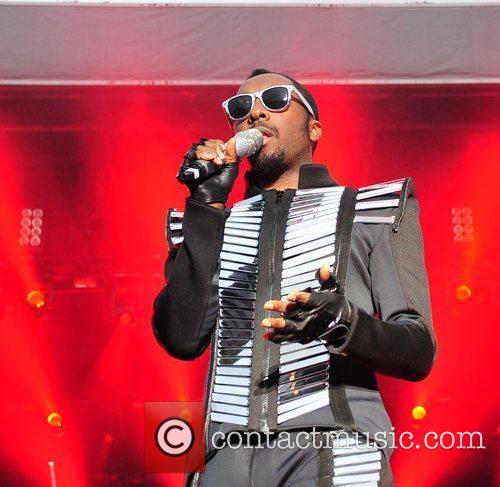 will.i.am The Black Eyed Peas perform in concert...